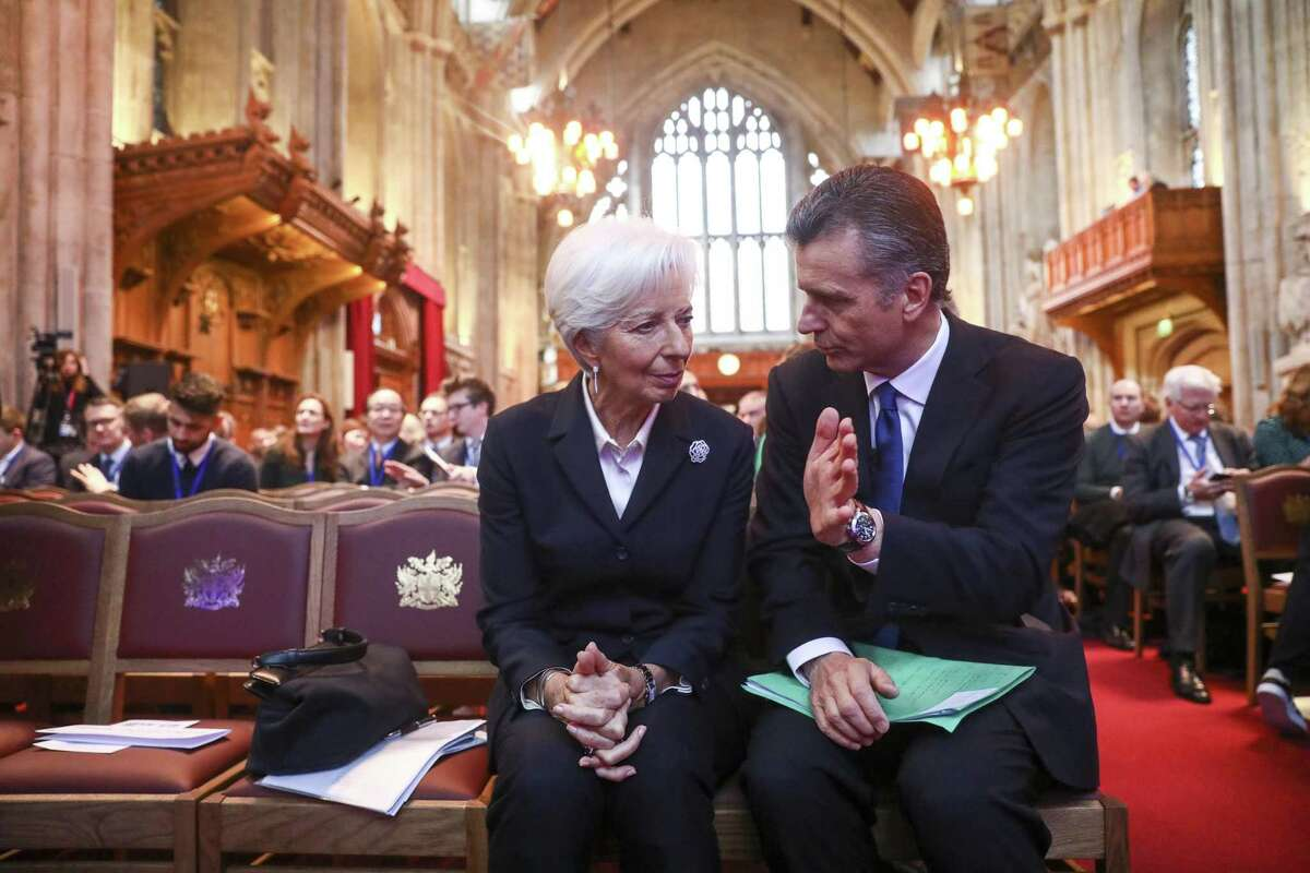 Philipp Hildebrand, vice chairman of Blackrock Inc., right, speaks to Christine Lagarde, president of the European Central Bank (ECB), as they attend at the launch of the COP26 Private Finance Agenda in London, U.K., on Thursday, Feb. 27, 2020. In a world facing a climate crisis, investors need to start taking account of carbon emissions and rising temperatures in their decisions, according toBank of EnglandGovernorMark Carney. Photographer: Simon Dawson/Bloomberg