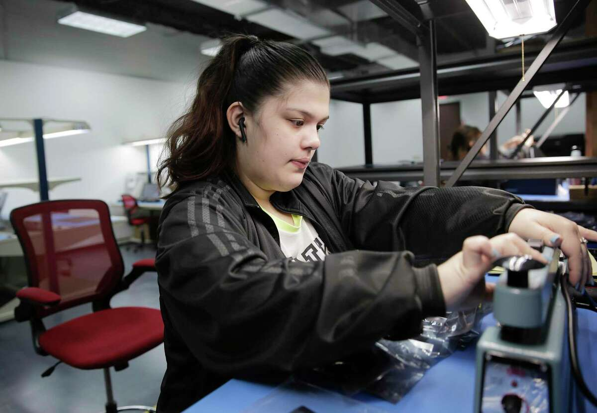 Monica Salazar, an assembly technician, prepares items to be shipped out from MacroFab, a Houston electronics manufacturer and manufacturing platform, on Friday, March 6, 2020. MacroFabs is one of many local businesses that are intricately connected with the global economy and are already feeling the impact of the coronavirus to their business.