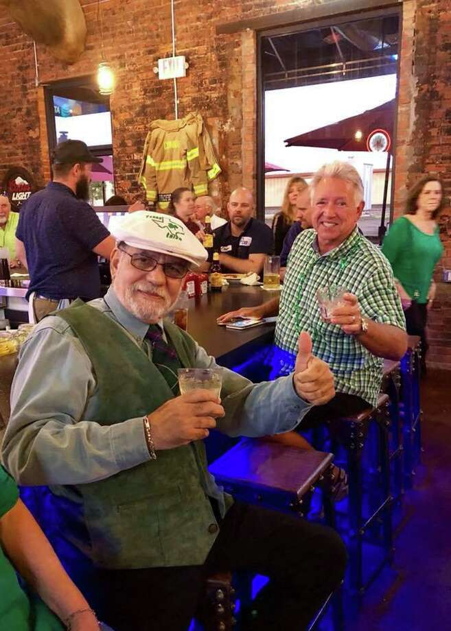 """Rotarians Michael McBride and Bill Rathbun enjoy an adult beverage at Pacific Yard House on March 17, 2018 after the """"St Patrick's Day Walking Parade Around The Square"""" in downtown Conroe. The parade is back this year on Tuesday, March 17, at 5 p.m. gathering in front of The Red Brick Tavern."""