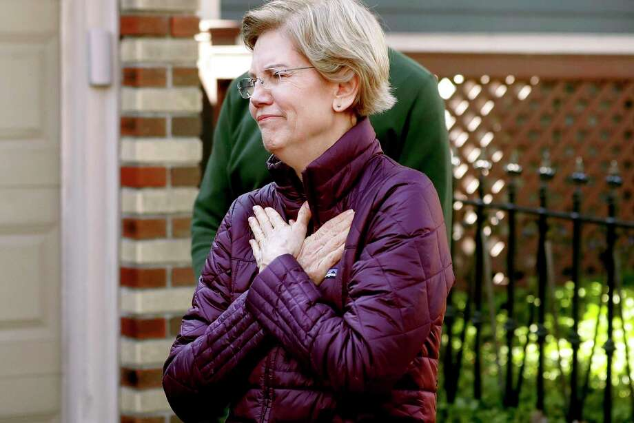Sen. Elizabeth Warren, D-Mass., acknowledges supporters as she arrives to speak to the media outside her home in Cambridge, Mass., March 5 after she dropped out of the Democratic presidential race. Photo: Steven Senne / Associated Press / Copyright 2020 The Associated Press. All rights reserved