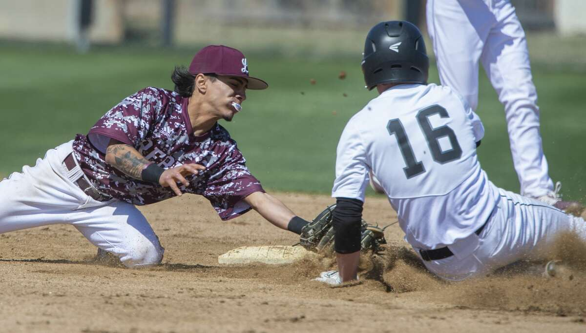 Lee High's Niko Rubio looks to make the tag as Canyon Randall's Miles Strobel steals second, but is safe after a ball 4 call at the plate 03/06/2020 at Ernie Johnson Field during the Tournament of Champions. Tim Fischer/Reporter-Telegram