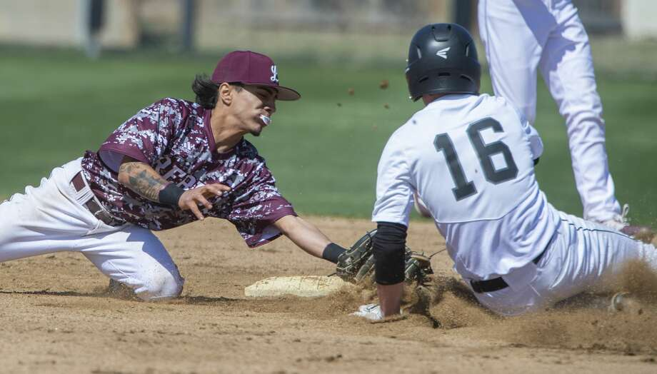 Lee High's Niko Rubio looks to make the tag as Canyon Randall's Miles Strobel steals second, but is safe after a ball 4 call at the plate 03/06/2020 at Ernie Johnson Field during the Tournament of Champions. Tim Fischer/Reporter-Telegram Photo: Tim Fischer/Midland Reporter-Telegram
