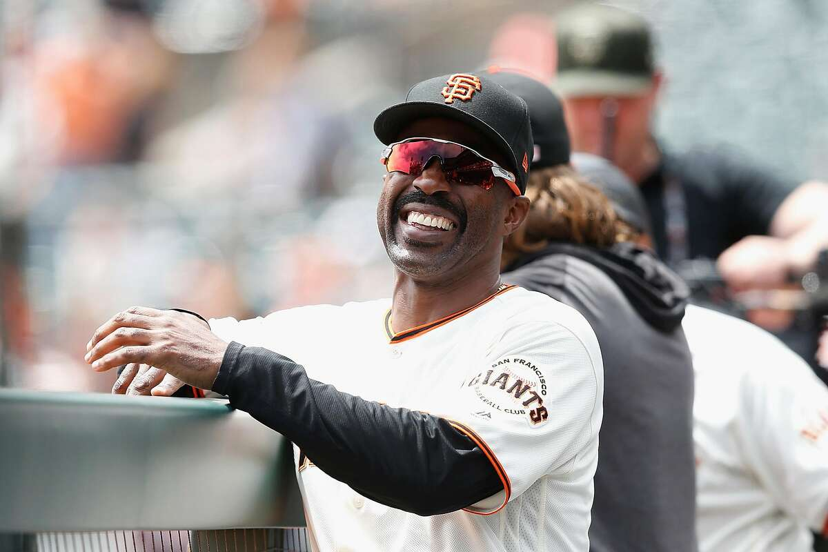 SAN FRANCISCO, CALIFORNIA - AUGUST 10: Member of the San Francisco Giants staff Shawon Dunston #21 shares a laugh with players before the game against the Philadelphia Phillies at Oracle Park on August 10, 2019 in San Francisco, California.