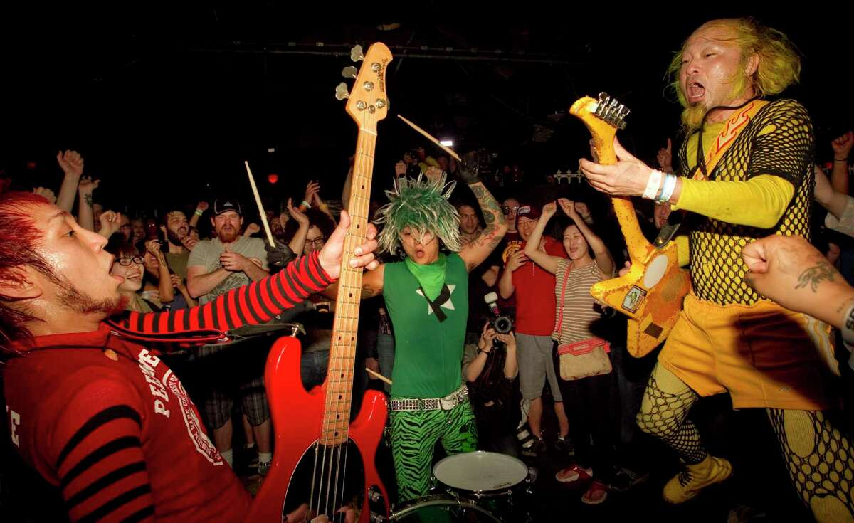 New York punk band Peelander-Z, performs in the middle of the audience at a show at Elysium during SXSW in Austin, Texas, on Wednesday March 16, 2011. (AP Photo/Austin American-Statesman, Jay Janner) MAGS OUT; NO SALES; TV OUT; INTERNET OUT; AP MEMBERS ONLY