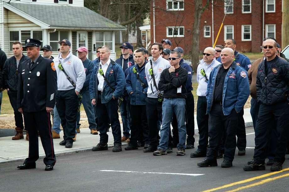 A dedication of the bridge that spans the Providence and Worcester Railroad on West Street in Middletown was held Friday in honor of the late fire Capt. Joseph Pagano. He died in the line of duty Nov. 3, 2006. Several dozen state and local officials, firefighters, family and friends gathered for the observance. Photo: David Bauer Photo