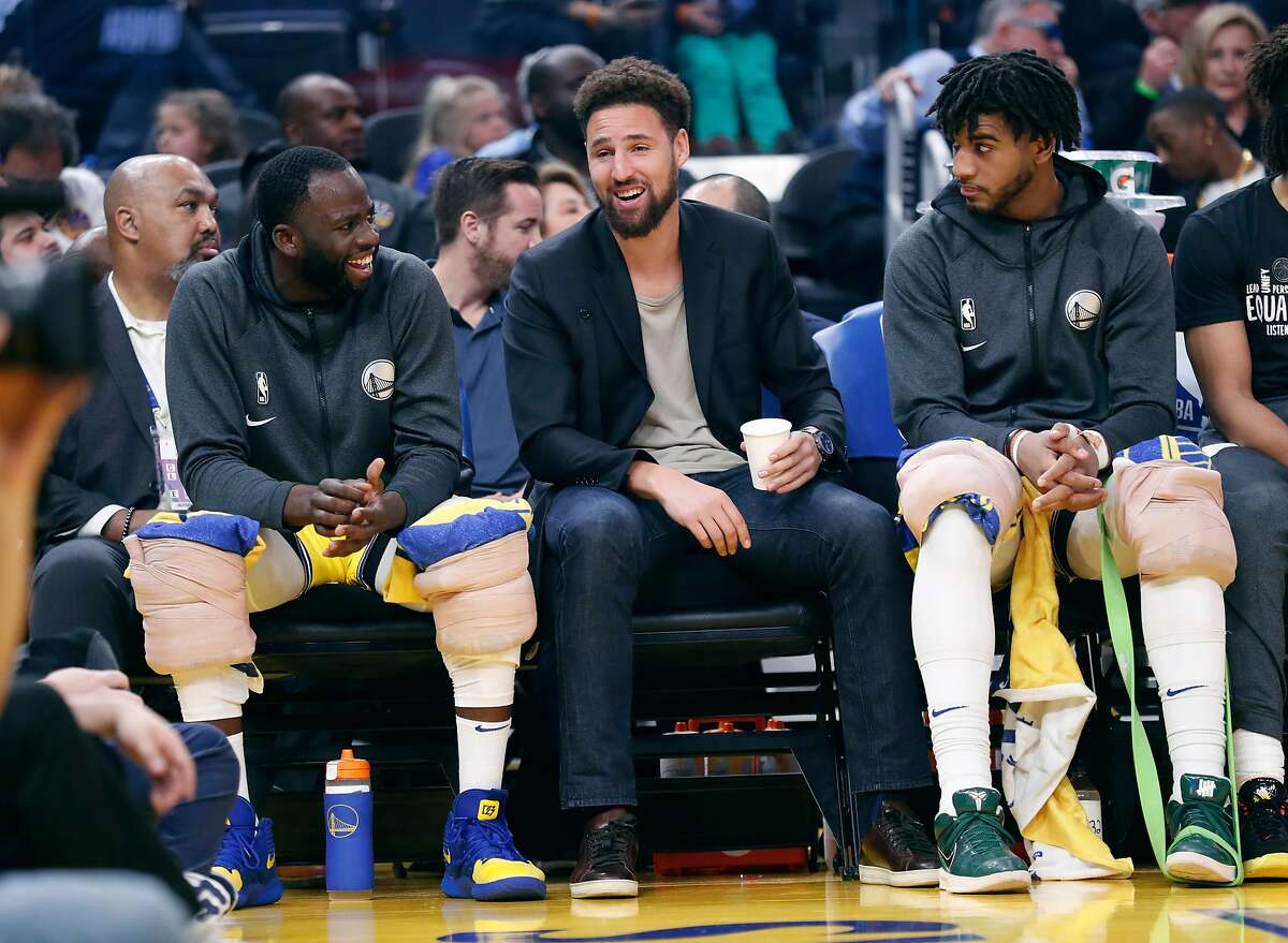 Golden State Warriors' Draymond Green, Klay Thompson and Marquese Chriss during 1st quarter of 116-86 loss to Los Angeles Lakers in NBA game at Chase Center in San Francisco, Calif., on Thursday, February 27, 2020.
