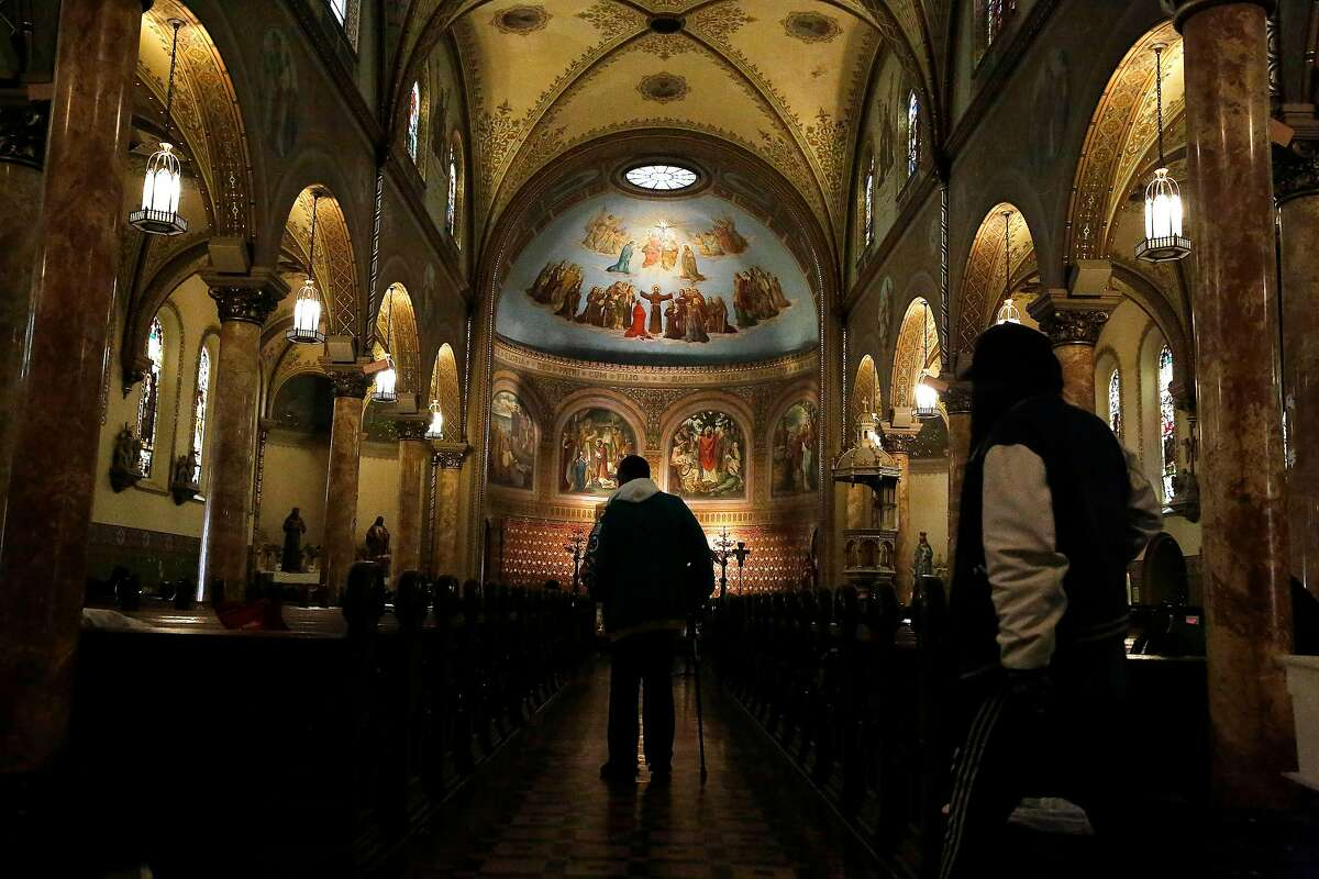 Visitors to the Gubbio Project walk through St. Boniface Church on Thursday, March 5, 2020 in San Francisco, Calif.