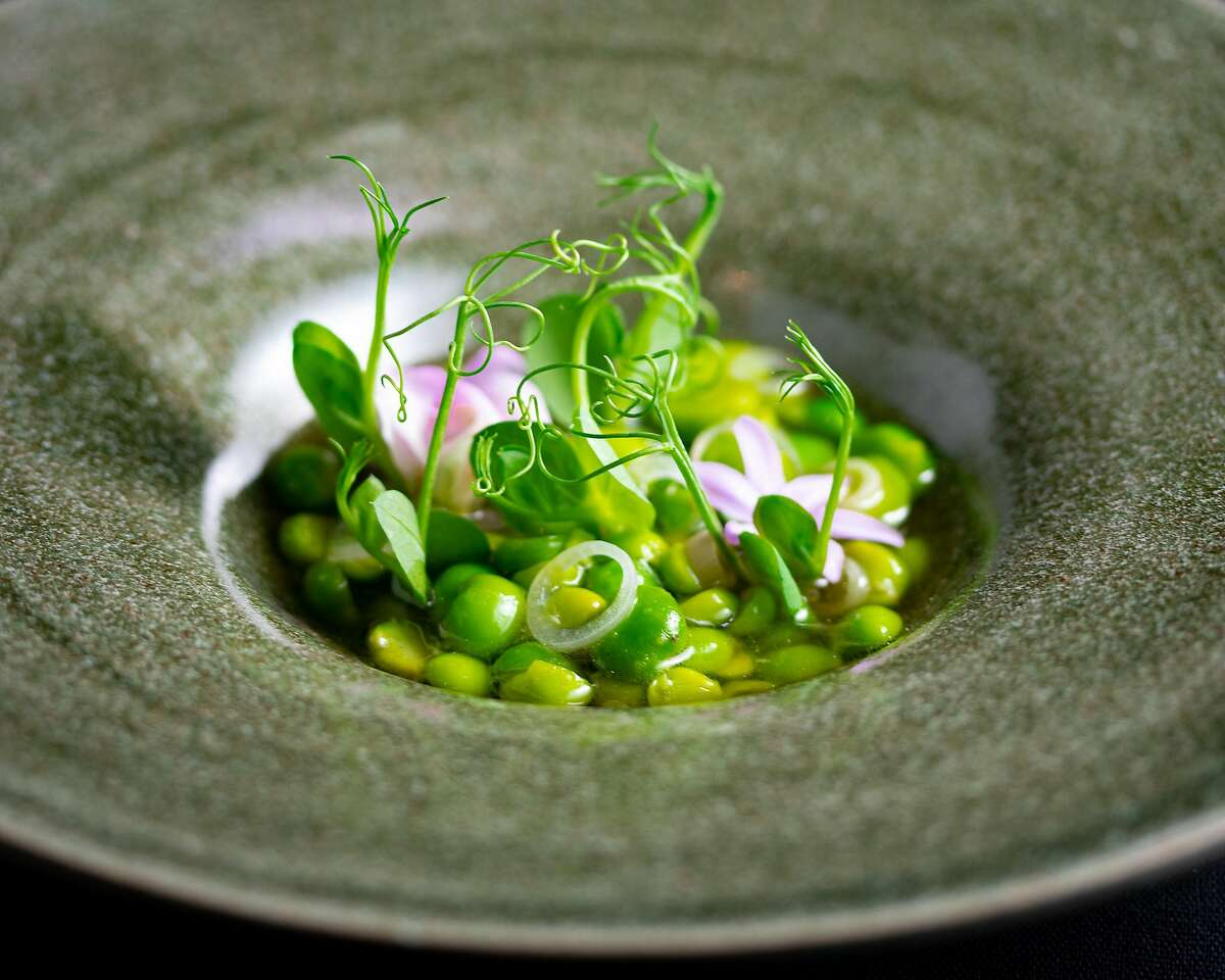 English peas with pickled ramps and spring onion soubise at San Francisco restaurant Lazy Bear, which is going vegan for nine days in April.