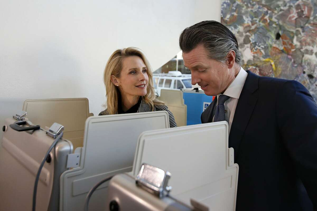 Gov. Gavin Newsom and his wife, Jennifer Siebel Newsom, as they vote in the California primary on March 3 in Sacramento. The couple attended a party at the French Laundry restaurant in Napa on Nov. 6 that included people from several households, the type of gathering Newsom's administration has discouraged during the coronavirus pandemic.
