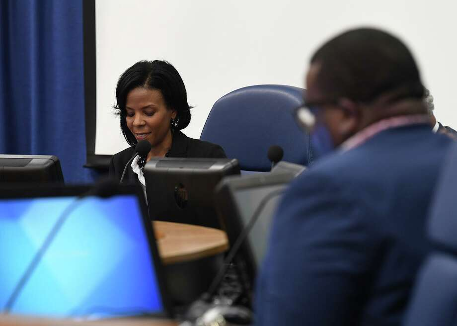 Shannon Allen, center, was voted in as Beaumont Independent School District's newest superintendent in a five to zero vote during Wednesday afternoon's board meeting. One abstention was made by Alexandrew Seale. Allen talks to A.B. Bernard, right, and Nathan Cross after the meeting.  Photo taken Wednesday, 4/17/19 Photo: Drone Image: Guiseppe Barranco/The Enterprise, Photo Editor / Guiseppe Barranco ©