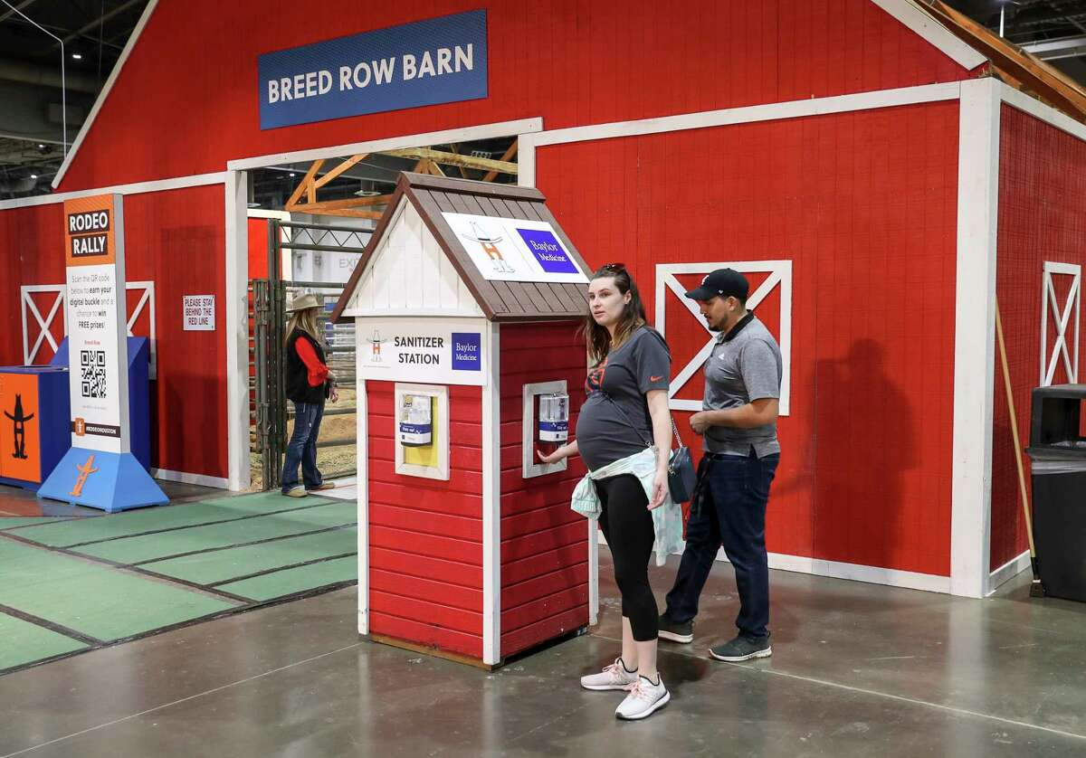 """""""I have a baby on the way, I kind of have to be prepared,"""" said Morgan Reynoso after she and her husband Jacob got hand sanitizer from a station at the Houston Livestock Show and Rodeo on Friday, March 6, 2020, at NRG Center in Houston. """"There's more things to be concerned about in this world,"""" she said. """"The flu kills more people."""""""