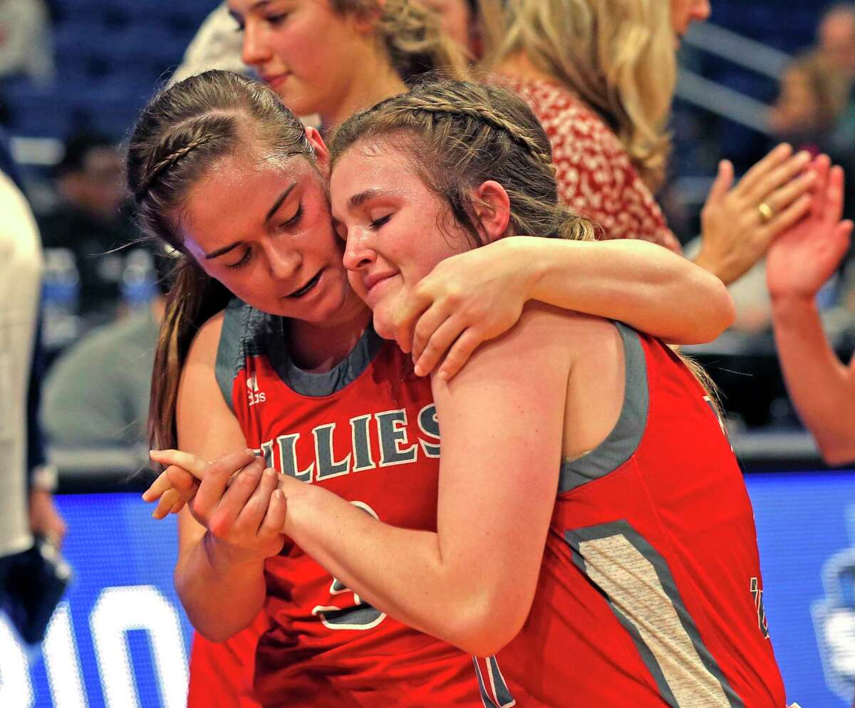 Fredericksburg's Ella Hartman, left, consoles teammate Brittley Bowers. Hartman led the Billies with 18 points in Friday's loss.