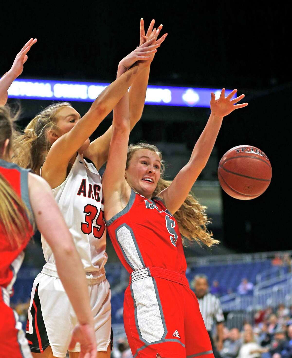 Argyle forward Shelby Henches #35 battles Fredericksburg forward Caitie Huff #5 in Class 4A state semifinal where Argyle defeated Fredericksburg 49-38 on Friday, March 6, 2020 at the Alamodome. (Ron Cortes/Contributor)