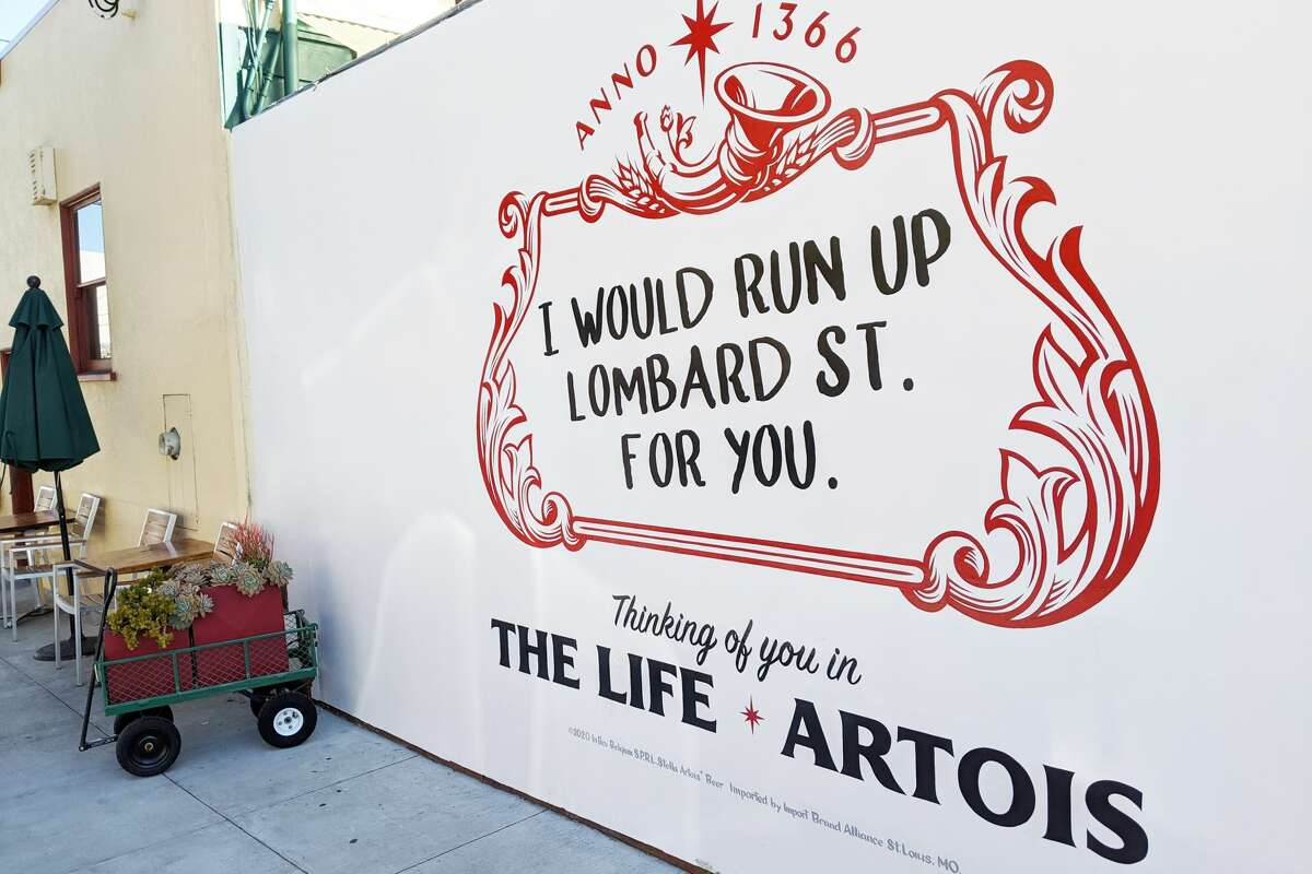A temporary mural advertisement outside Atlas Cafe in the Mission that ran during the month of February in 2020.