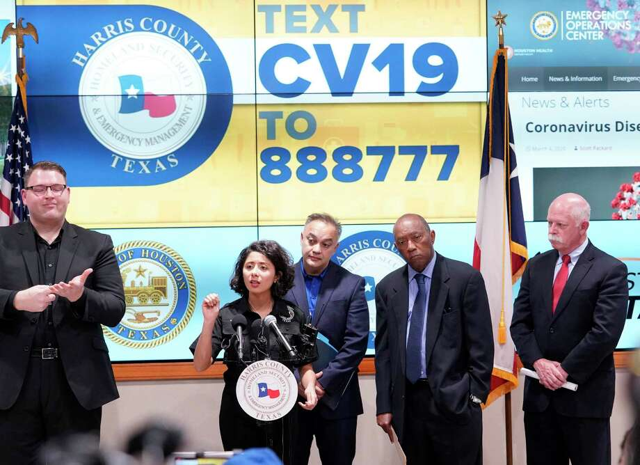 Harris County Judge Lina Hidalgo, left, speaks as Dr. Umair Shah, executive director of Harris County Public Health, Houston Mayor Sylvester Turner, and Dr. David Persse, Houston Health Department, listen about the first two cases of coronavirus in Harris County during media conference at Houston Transtar Thursday, March 5, 2020 in Houston. One man and one woman in the unincorporated area of northwest Harris County tested positive for COVID-19, according to county officials.  Both patients, and the man in Fort Bend county that tested positive for COVID-19, had traveled together to Egypt. Photo: Melissa Phillip, Houston Chronicle / Staff Photographer / © 2020 Houston Chronicle