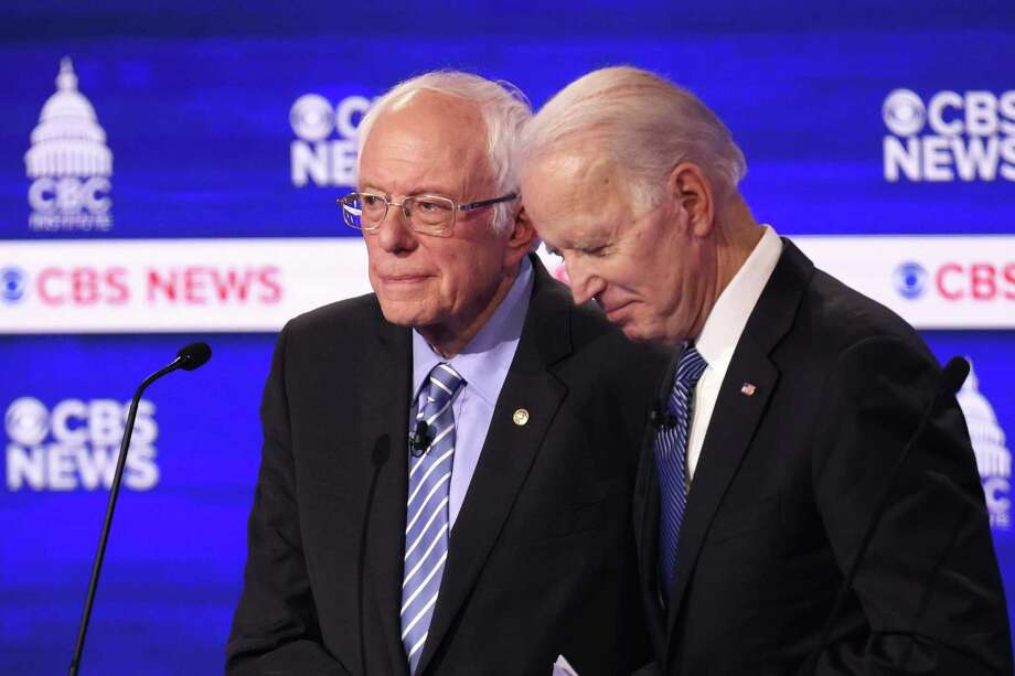 Democratic presidential candidates Sen. Bernie Sanders (I-VT) and former Vice President Joe Biden speak during a break at the Democratic presidential primary debate at the Charleston Gaillard Center on February 25, 2020 in Charleston, S.C. They are expected to be the only two to qualify for the next debate.  (Win McNamee/Getty Images/TNS) Photo: Win McNamee, HO / TNS / Getty Images North America
