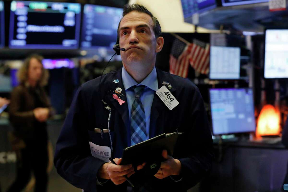 Gregory Rowe works on the floor of the New York Stock Exchange on Friday, when the price of crude dropped to $41 a barrel.