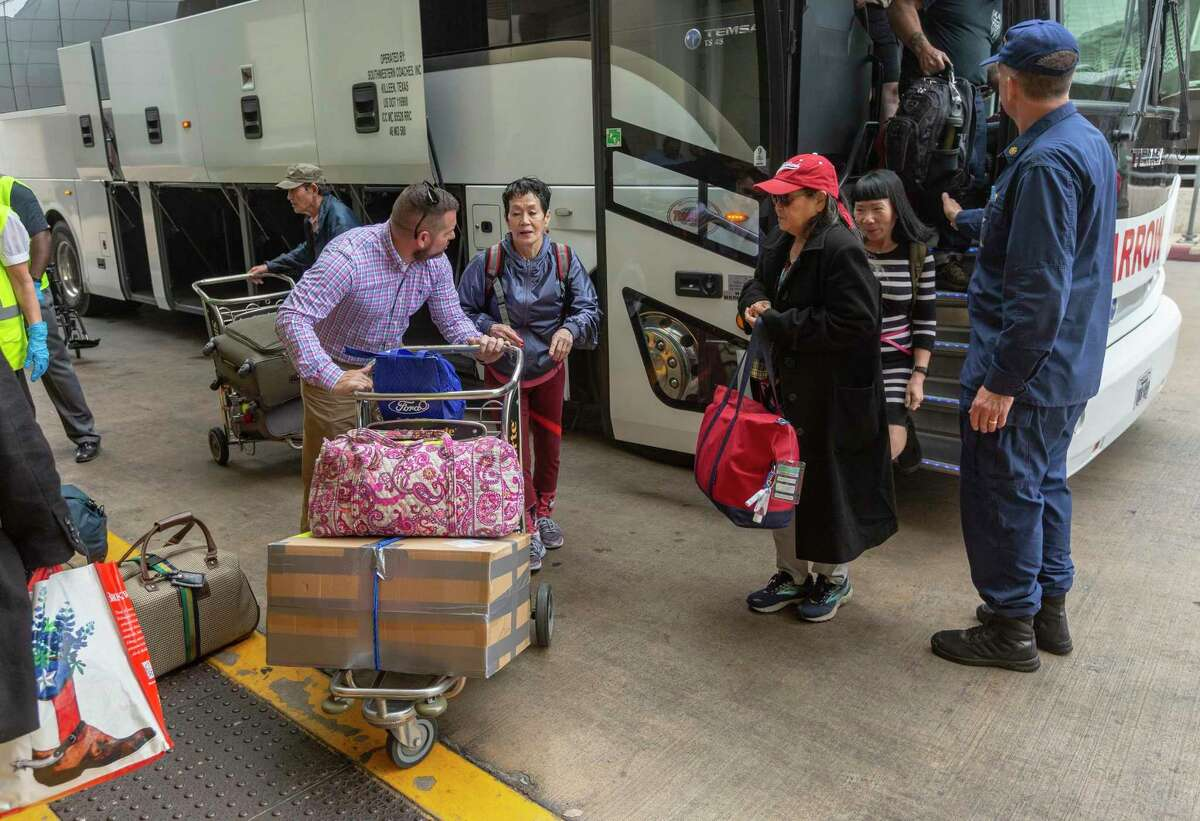 Evacuees from the Diamond Princess arrive at San Antonio International Airport on Tuesday, March 3, 2020, after being released from quarantine at Joint Base San Antonio-Lackland. They were not infected by the coronavirus and were allowed to leave after 14 days under quarantine at Lackland.