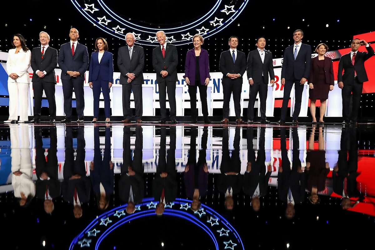WESTERVILLE, OHIO - OCTOBER 15: Democratic presidential candidates (L-R) Rep. Tulsi Gabbard (D-HI), billionaire Tom Steyer, Sen. Cory Booker (D-NJ), Sen. Kamala Harris (D-CA), Sen. Bernie Sanders (I-VT), former Vice President Joe Biden, Sen. Elizabeth War