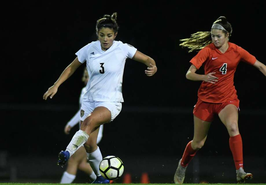 Klein Collin's Riley Keck (3) pushes the ball upfield against The Woodlands junior midfielder Marley Krach (4) during the first period of their District 15-6A matchup at KCHS on Feb. 14, 2020. Photo: Jerry Baker, Houston Chronicle / Contributor / Houston Chronicle