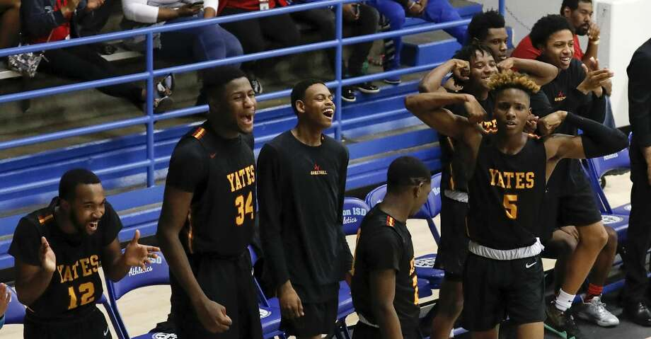 The Yates Lions bench celebrates during the high school basketball game between the between the Yates Lions and the Scarborough Spartans at The Pavilion in Houston, TX on Tuesday, February 11, 2020. Photo: Tim Warner/Contributor