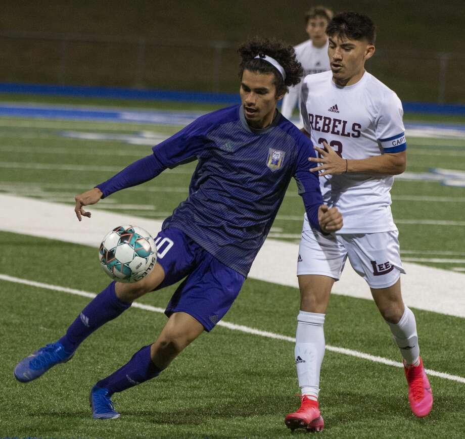 Midland High's Daniel Olivas tries to control the ball as Lee High's Alexis Guevara defends 03/06/2020 at Grande Communications Stadium. Tim Fischer/Reporter-Telegram Photo: Tim Fischer/Midland Reporter-Telegram