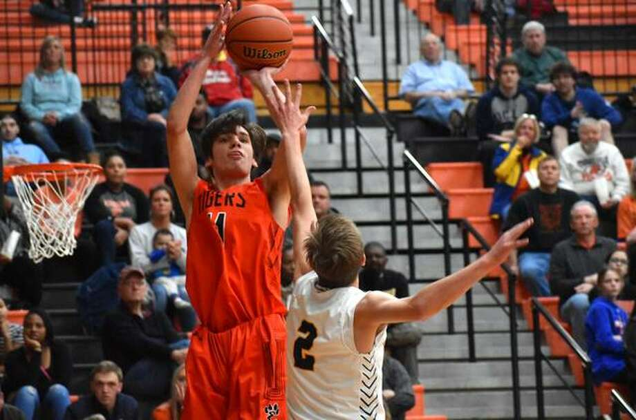 Edwardsville junior forward Brennan Weller puts up a shot over O'Fallon's Logan Lowery in the first quarter of Friday's Class 4A Edwardsville Regional championship game inside Lucco-Jackson Gymnasium in Edwardsville. Photo: Matt Kamp|The Intelligencer
