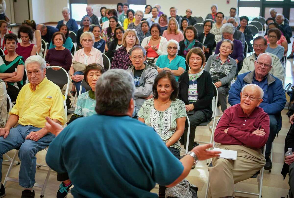 A full meeting room of seniors listen as Dr. Joe A. Anzaldua, the local health authority for the city of sugar land, talks about how they can better prepare themselves against coronavirus Thursday, March 5, 2020, at T.E. Harman Center in Sugar Land. The center for senior adults 50 years of age and older held the meeting with county health officials in response to the recent news of a 70-year-old man in Fort Bend county said to have COVID-19.