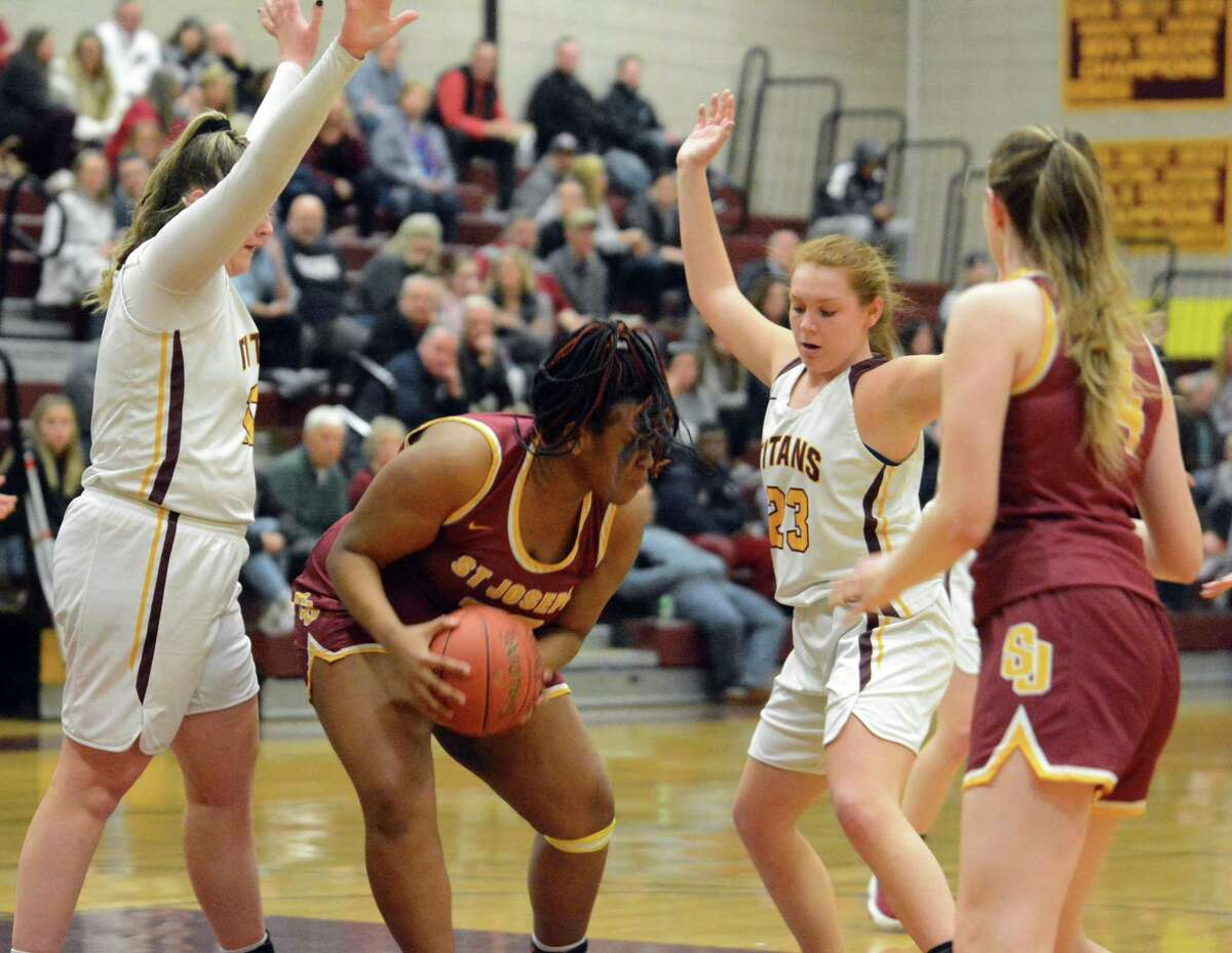 Sheehan's Dempsey Lajoie (23) and Caitlyn Hunt (13) guard St. Joseph's Kirsten Rodriguez during a Class MM tournament game on Friday.