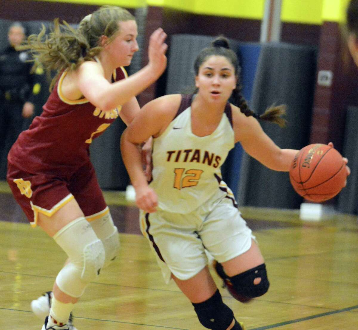 Sheehan's Caitlyn Velez dribbles downcourt during a Class MM tournament game on Friday.