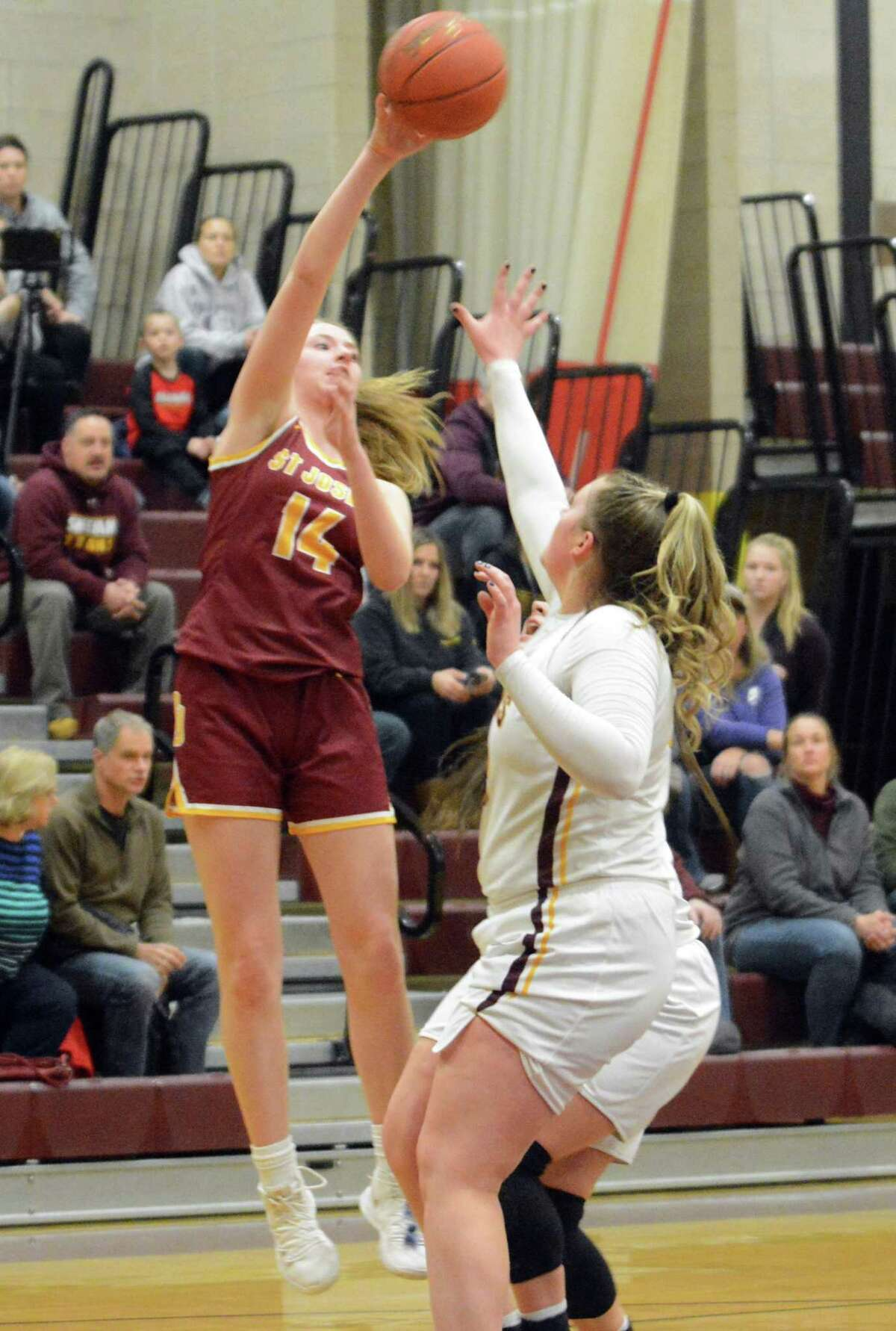 St. Joseph's Katherine Rudini shoots over Sheehan's Caitlyn Hunt during a Class MM tournament game on Friday.