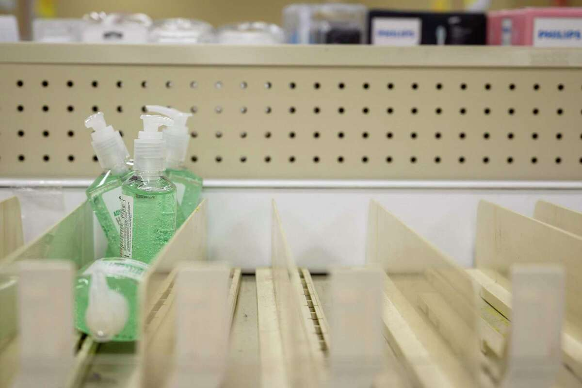 These are the remaining bottles of ready-made hand sanitizer on a shelf at the H-E-B store in Olmos Park.