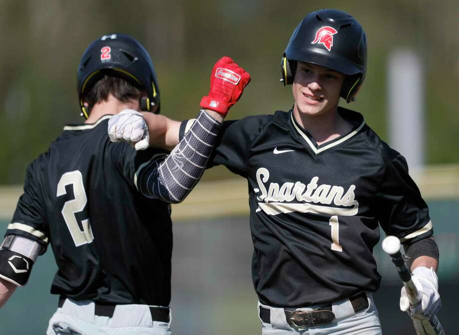 Porter's Jake Tatom, right, celebrates with Conner Westenburg after scoring on a bases-loaded walk during the second inning of a high school baseball game at Porter High School, Friday, March 6, 2020, in Porter. Photo: Jason Fochtman, Houston Chronicle / Staff Photographer / Houston Chronicle  © 2020