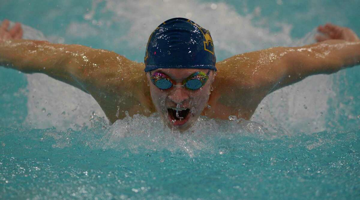 Newtown's Mason Suba competes in the mixed 100-yard Butterfly during the SWC championships on Friday in Monroe.