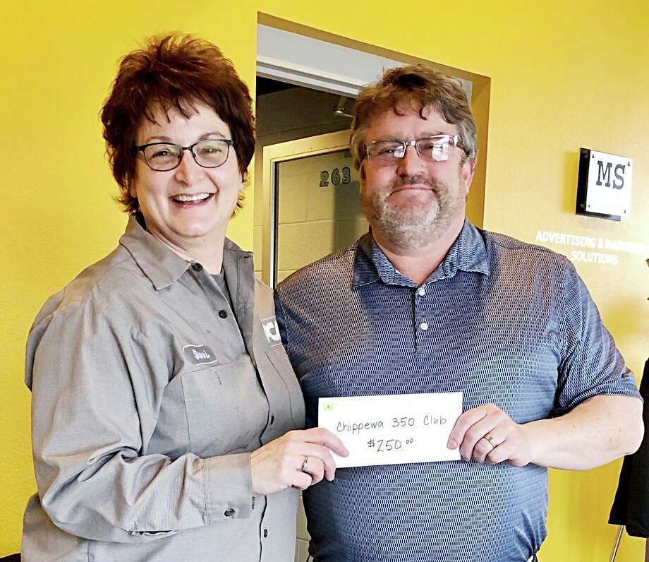 Sherri Wehrmeister of the Filer Mill Community Club makes a donation to Mark Sandstedt, President of the Chippewa 350 Club. (Courtesy photo)