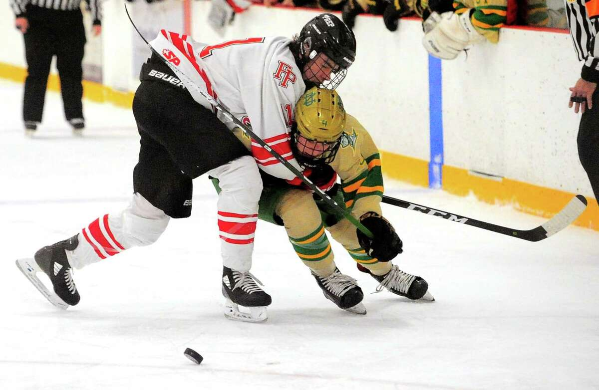 Fairfield Prep's Joseph Bisset (11) collides with Notre Dame of West Haven's Joseph D'Agostino III (4) Friday.