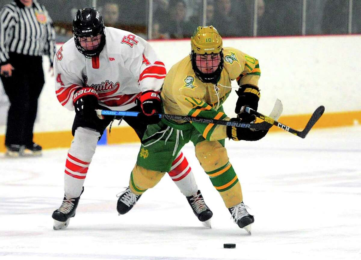 Fairfield Prep's Seamus Carolan (4) pressures Notre Dame of West Haven's John D'Errico (10) as he chases the puck during SCC Div. I hockey championship in West Haven, Conn., on Friday Mar. 6, 2020.