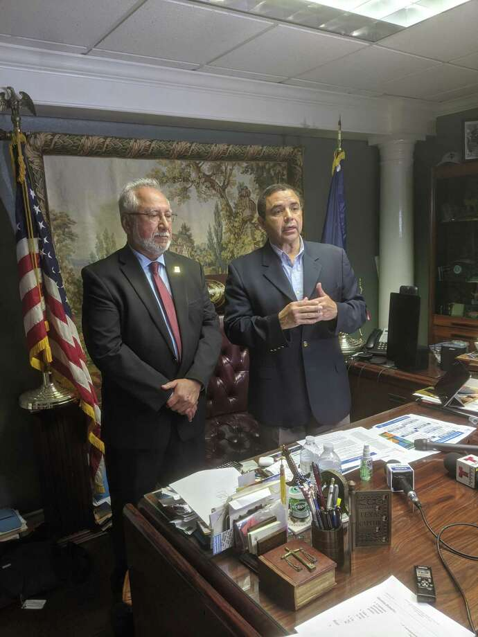 Rep. Henry Cuellar and Health Department Director Hector F. Gonzalez are pictured at a press conference Friday speaking about the $8.3 billion coronavirus supplemental bill passed by congress.  Photo: Foto De Cortesía