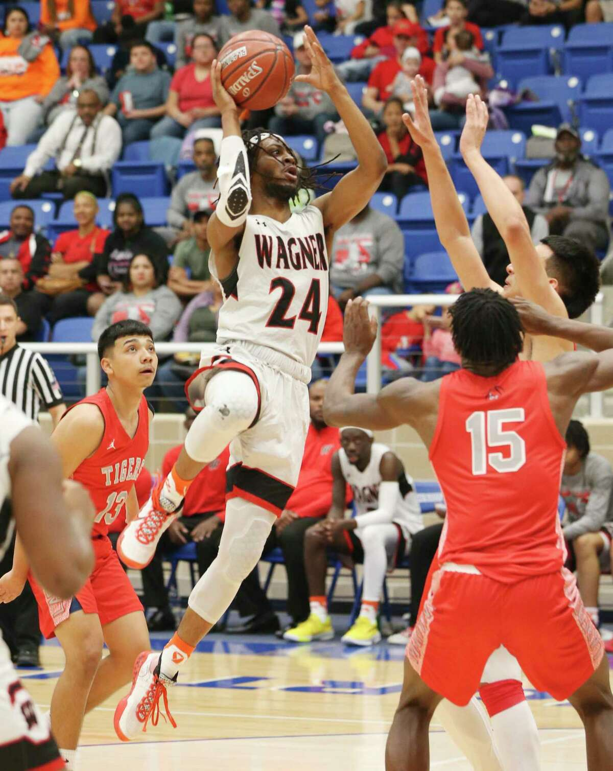 Wagner's Journee Phillips (24) attempts a score against Laredo Martin during their Boys 5A Regional semifinal basketball game on Friday, Mar. 6, 2020. Wagner defeated Laredo Martin, 58-47, to advance to the regional final game.