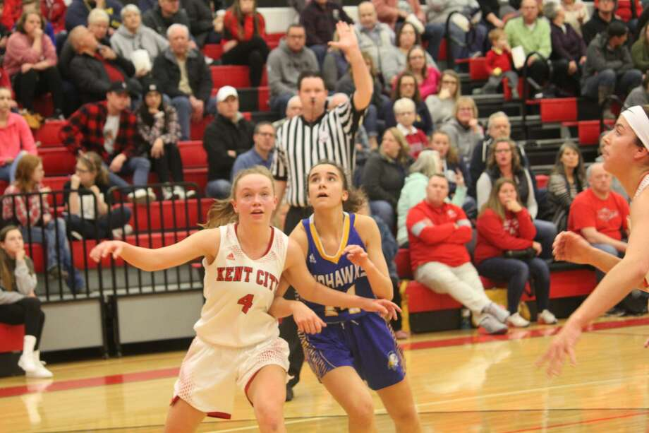 Kent City ended Morley Stanwood's girls basketball season with a 53-47 district title win on Friday. Photo: John Raffel