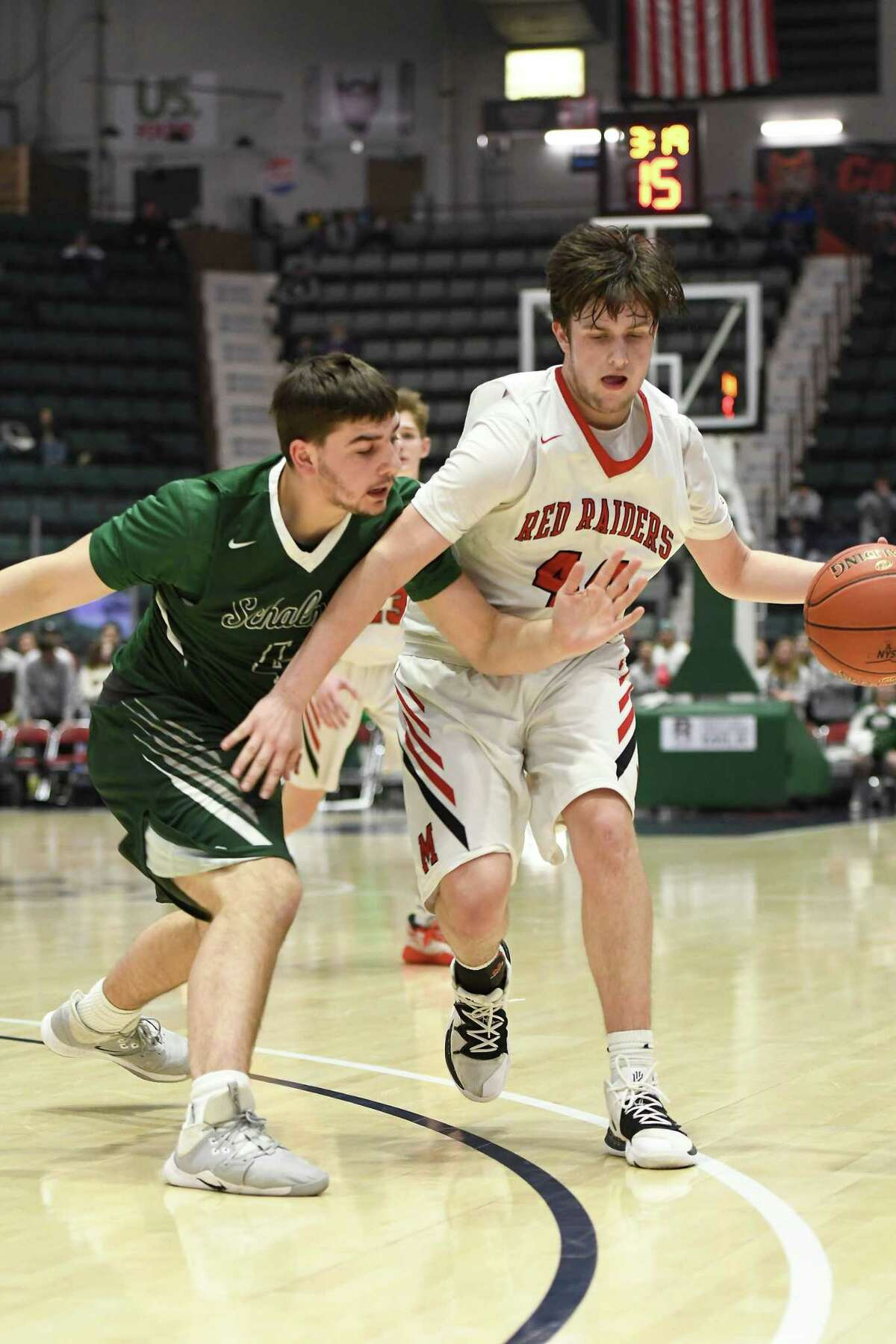 Schalmont's Sean Clifford pressures Mechanicville's Devin Garland during the Class B Sectional Final at Cool Insuring Arena in Glens Falls, N.Y., on Friday, Mar. 6, 2020. (Jenn March, Special to the Times Union)