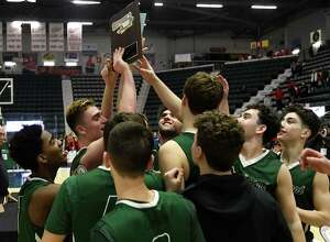 Schalmont basketball players touch the Section II Championship plaque following their victory over Mechanicville in the Class B Sectional Final at Cool Insuring Arena in Glens Falls, N.Y., on Friday, Mar. 6, 2020. (Jenn March, Special to the Times Union)