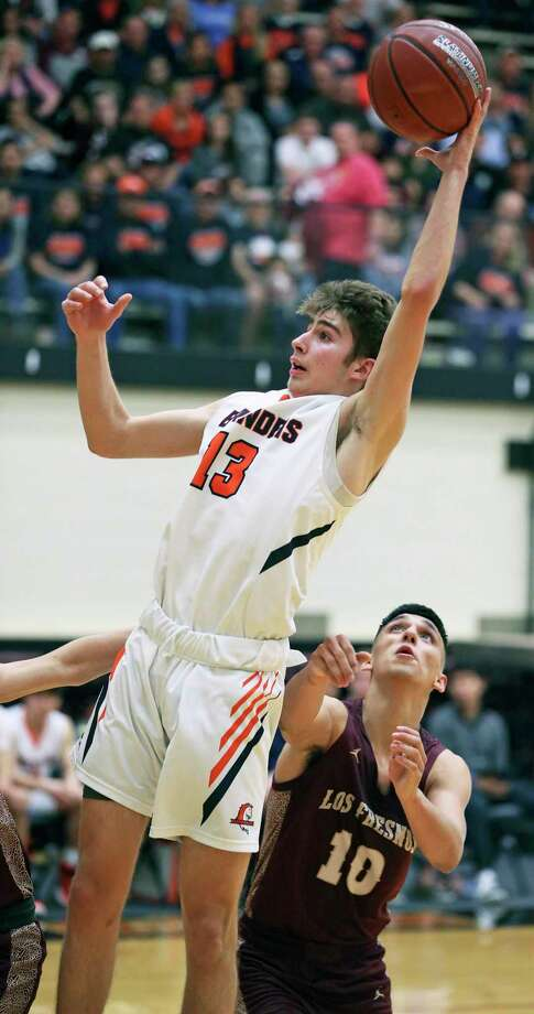 Tanner Brown claims a rebound for the Broncos as Brandeis plays Los Fresnos on Class 5A regional semifinal basketball at Littleton Gym on Feb. 6, 2020. Photo: Tom Reel, San Antonio Express-News / Staff Photographer / **MANDATORY CREDIT FOR PHOTOG AND  SAN ANTONIO EXPRESS-NEWS/NO SALES/MAGS OUT/TV