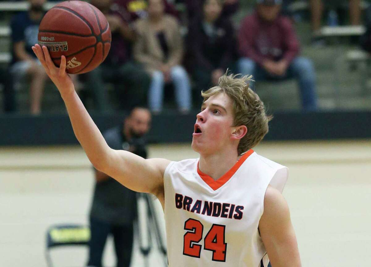 Brandeis guard Kyle Schaefer lays in a shot as the Broncos play Los Fresnos on Class 5A regional semifinal basketball at Littleton Gym on Feb. 6, 2020.