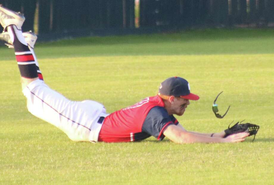 As his sunglasses go flying, Clear Lake left fielder John Davis saves two runs with this electrifying catch to end the second inning Friday night. Photo: Robert Avery