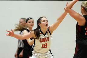 The Ubly girl basketball team won a district championship with a 42-31 win over Kingston on Friday, March 6.