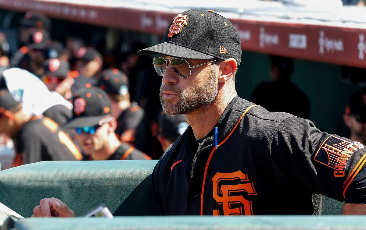 San Francisco Giants' head coach Gabe Kapler watches from the dugout before their game with the Cleveland Indians at Scottsdale Stadium Thursday, March 5, 2020, in Scottsdale, Arizona.