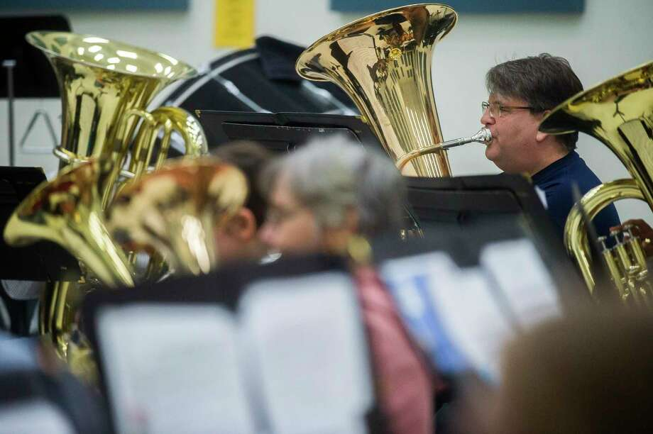 Jim Schutz of the Mid Michigan Brass Band rehearses with the group Monday evening at Midland High School. the Midland-based group will perform at the North America Brass Band Association on April 17-18 in Fort Wayne, Indiana. (Katy Kildee/kkildee@mdn.net)