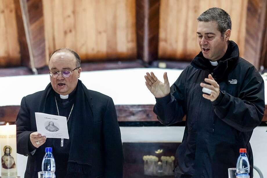 Archbishop Charles Scicluna (left) and Monsignor Jordi Bertomeu are the Vatican's leading sex crimes investigators. Photo: Fernando Lavoz / Associated Press 2018
