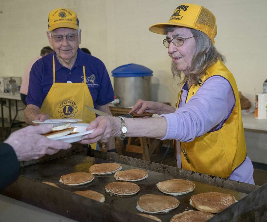 Lions Club members Jackie Matthews and Bob Price serve pancakes 03/07/2020 during the 64th annual Pancake Jamboree benefiting the Downtown Lions Club. Tim Fischer/Reporter-Telegram Photo: Tim Fischer/Midland Reporter-Telegram